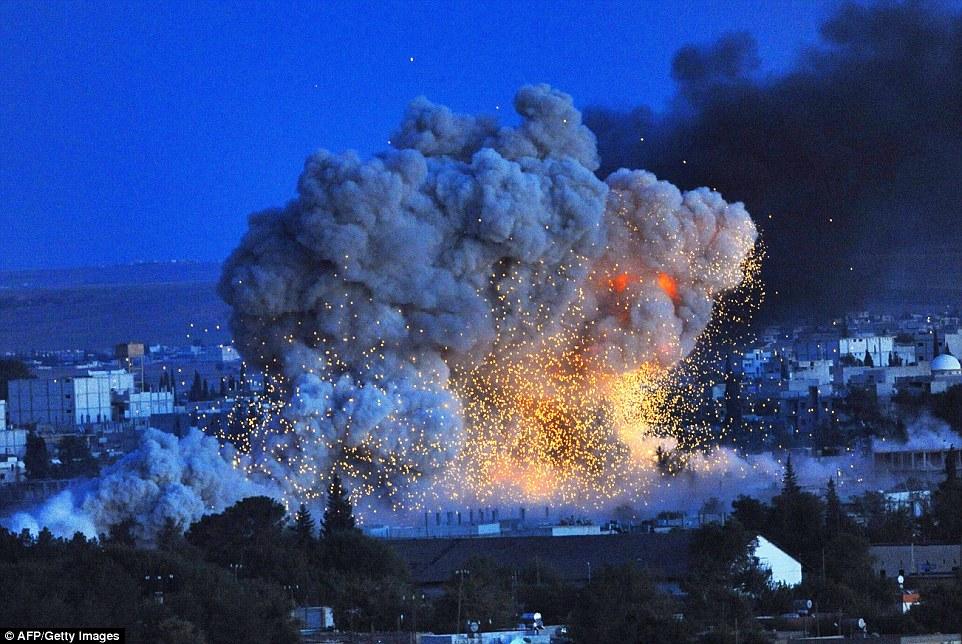 1413888908391_wps_24_Smoke_and_flames_rise_fol